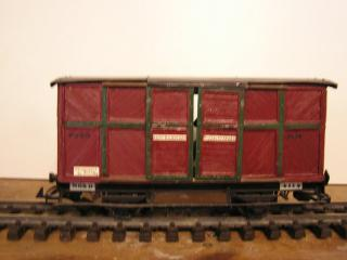 Couvert à essieux bois